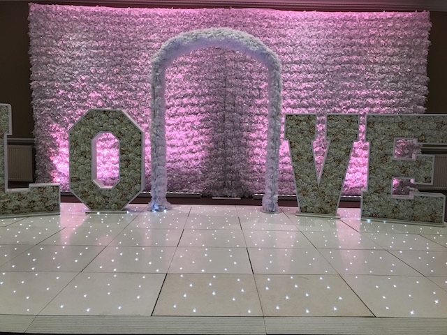 Flower Wall - Purple Uplighting - Floral LOVE Letters - Flower Archway - White Starlight Dance Floor - Hollins Hall - Wedding